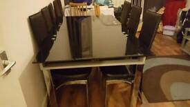 Black glass dining table & 8 chairs
