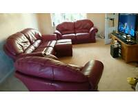 Large three piece dfs dark red sofa and footstool