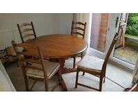 Ercol solid oak extending table and 6 chairs(2 carvers). Excellent condition. Medium oak in colour.