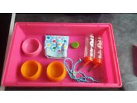 Pink hamster cage with lots of accessories