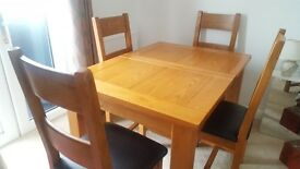 BHS Solid wood dining table and six chairs.