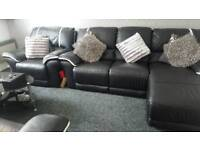Black and white leather reclining sofa with coffee table