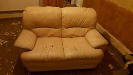 Used Two seater cream leather sofa
