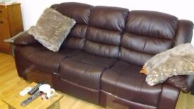Three seater and 2 seater leather effect reclining suite approx 3 months old