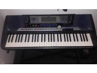 Yamaha psr 540 with floppy disks and stand