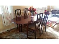 Mahogany extending dining room table and 4 chairs