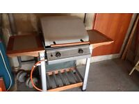 Hooded Gas Barbecue movable with wheels, rain cover and gas cylinder fitting