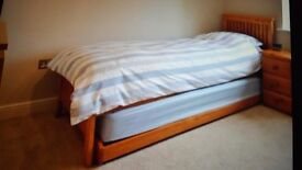 Single wooden trundle bed and two mattresses