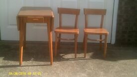 Folding table with two chairs