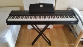 Classenti P1 piano, including stand and power lead.