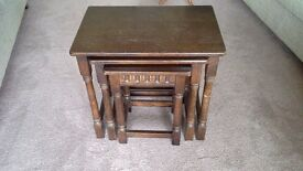 Dark wood solid nest of tables. In good condition.