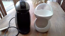 Dolce Gusto coffee pod machine and pod holder.