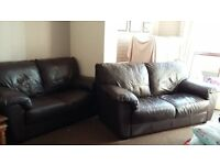 Two faux leather sofas