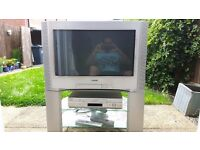Silver Sony TV 26 inches with Sony video player and remote controls