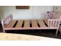 Pink single toddler bed with matters