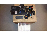 Playstation 2 console with games, controller, memory cards, singstar microphones