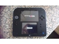 Nintendo 2DS, charger and 9 games.