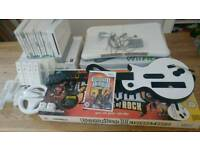 Nintendo Wii with guitar hero, games and wii fit