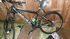Carrera vulcan mountain bike with recipt