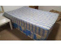 Double Divan and Mattress less than 1yr old - good condition. Free to collect