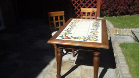 Italian kitchen table with inlaid tiled top, 4 matching chairs with cushions (John Lewis)