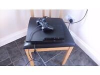 Playstation 3 with controllers andvgames