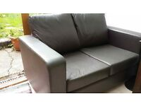 brown two-seater sofa in good condition