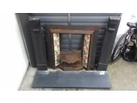 Victorian cast iron tiled fireplace with black slate fire surround