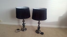 Two matching lamps with dark silver stand and black shade