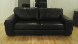 Black leather 3 seater sofa in immaculate condition - can seat 4