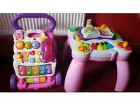 Girls vtech walker and leap from activity table