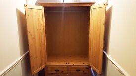 Large pine wood wardrobe with drawers. Very good condition.