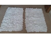 2 White washable rag rugs. £5 for the two.