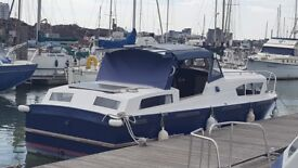 Boat 28 foot is good houseboat live aboard large rear cabin moored Southampton