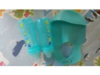 Feeding bottles and Bib in good condition