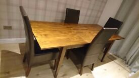 Extending 6-8 seater dining table and chairs