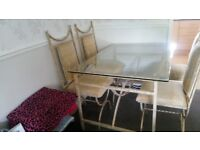 Glass top. Metal table and 4 chairs