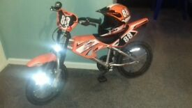 Kids bike and matching helmet for sale