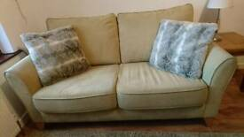 Lovely 2 seater sofa, pale green from Debenhams