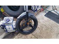 Malaguti front end. Forks, wheel, disk, caliper and tyre Avon Roadrunner 100/80-17