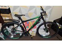 Carrera Hellcat Mountain Bike, as new barrly used