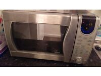 Bargain!!!! High powered microwave includes grilling and ovem functions top spec