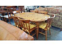 Pine extending dining table and six chairs with cushions