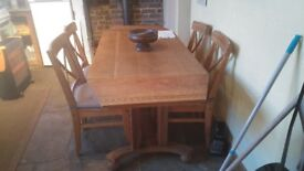 Large oak drop leaf dining table.4 free chairs