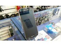 Samsung Galaxy S4 - unlocked to any network, scratch free with screen protector