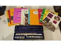 Flute with case & music books