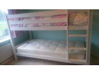 White wooden bunk bed with one premium mattress