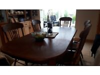 Beautiful table and chairs for sale with two carvers and four chairs.