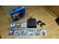 PS4 with 2 controllers and 9 games in original box