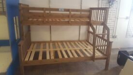 Brand new dark wood trio bunks
